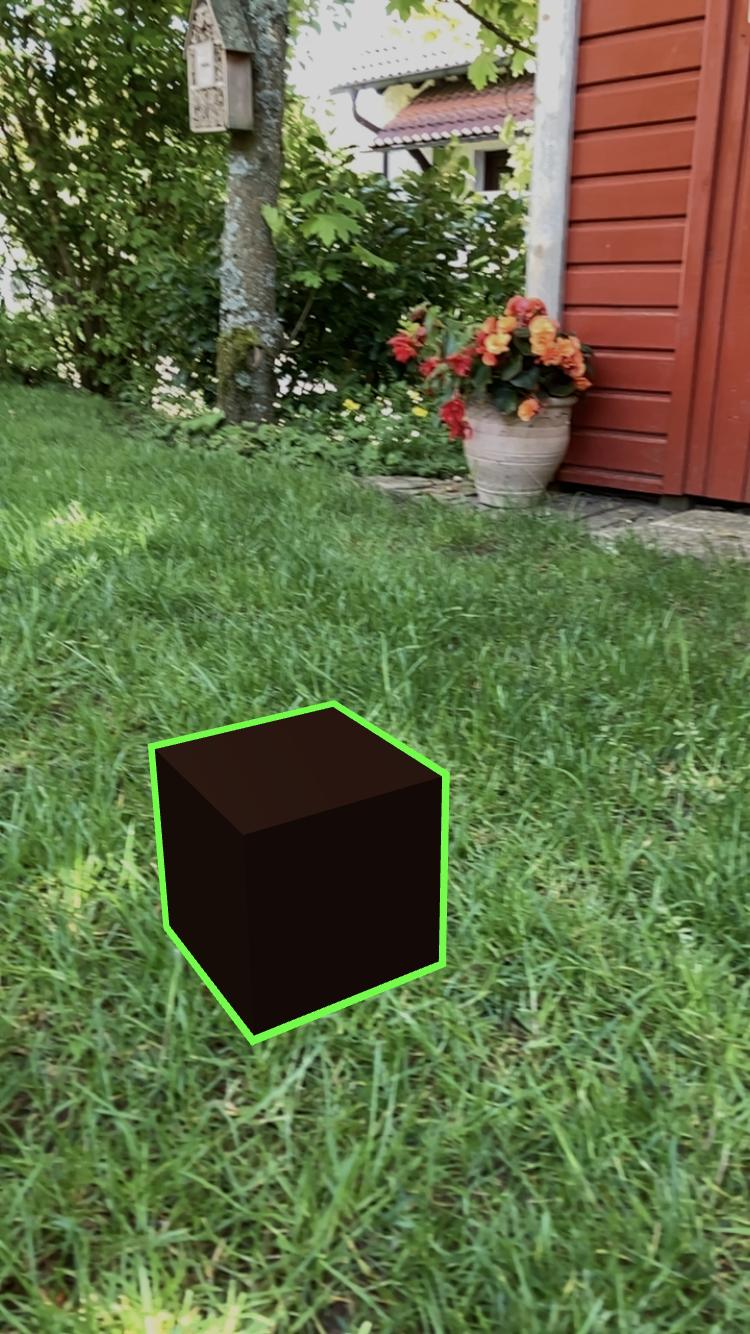 a virtual box on a real lawn